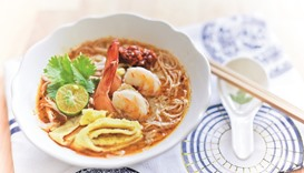 Laksa is a popular spicy noodle soup from the Peranakan culture, which is a merger of Chinese and Ma