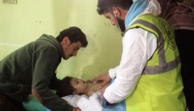 An unconscious Syrian child receiving treatment at a hospital in Khan Sheikhun, a rebel-held town in