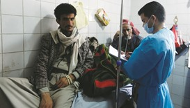 Yemeni men suspected of being infected with cholera receive treatment at a hospital in Sanaa yesterd