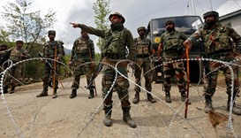 Indian army soldiers stand guard near their army base in Kashmir