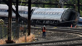 Workers at the scene of an Amtrak train derailment in Philadelphia (file photo)