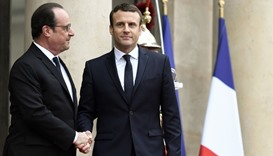 French newly elected President Emmanuel Macron (R) is welcomed by his predecessor Francois Hollande