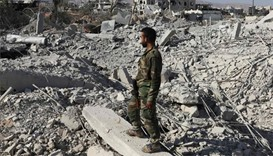 Over 1,500 rebels, families leave devastated Damascus district