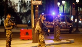 Man in custody over links to Champs-Elysees gunman