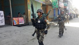 Afghan security forces arrive at the site of an attack in Jalalabad
