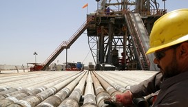 A man works for Iraqi oil company at Rumaila oilfield in Basra