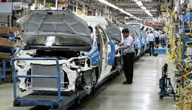 Employees work inside a plant of General Motors India Ltd. at Halol