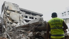 Rescuers try to save woman trapped in Colombo building