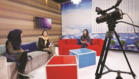 Presenters record their morning programme at the Zan TV station (women's TV) in Kabul.