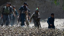 Afghan security force personnel patrol  the area