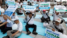 Protesters take part in a rally in Taipei against Taiwan being excluded from U.N.'s annual World Hea