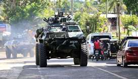 Duterte warns of harsh measures as civilians flee fighting