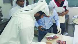 Municipality inspectors check for suspect meat