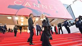 German director Fatih Akin and German actress Diane Kruger arrive for the closing ceremony of the 70