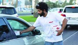 Ooredoo distributes water, dates to break fast