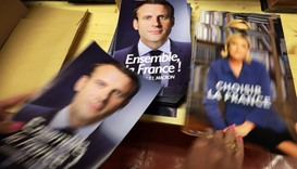 A civil servant prepares electoral documents for the upcoming second round of 2017 French presidenti