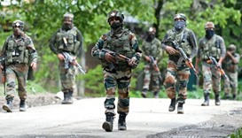 Indian army soldiers conduct a patrol in Shopian