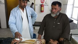 A Pakistani paramedic gives treatment to an injured victim at a hospital following cross border firi