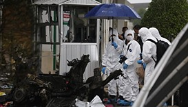 Thai forensic agents work at the site of a car bomb in the town centre of Pattani.