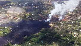 Smoke and volcanic gases rise as lava cools in the Leilani Estates neighborhood
