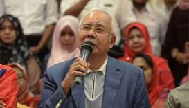 Police raid apartments linked to Najib's family