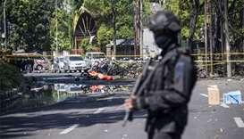 13 killed as suicide bombers attack churches in Indonesia