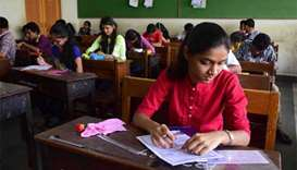 Indian exam women have sleeves cut to stop cheating