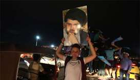 Iraqi poll results show cleric, paramilitary leader surging