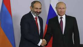 Russian President Putin shakes hands with Armenian PM Pashinyan during their meeting in Sochi