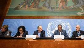 World Health Organization (WHO) Director General Tedros Adhanom Ghebreyesus (2nd R) is flanked by WH