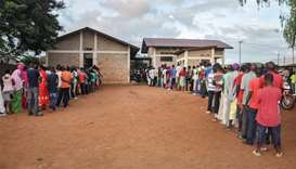 People wait in a line to vote for the referendum on a controversial constitutional reform in Ngozi,