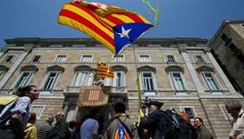 "A man waves an ""Estelada"", Catalan separatist flag, outside the Generalitat Palace in Barcelona"