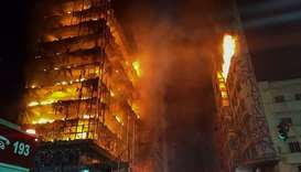 Flames engulfing a building in the city centre of Sao Paulo.