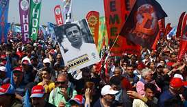 A demonstrator holds up a poster of Selahattin Demirtas during a May Day rally in Istanbul, Turkey
