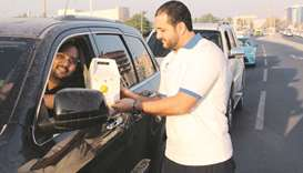 QCS distributes Iftar boxes to motorists