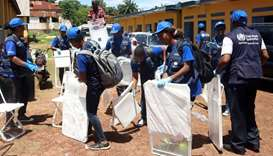 World Health Organization workers prepare a centre for vaccination during the launch of a campaign a