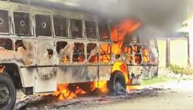 A bus burns during a protest against the construction of a copper smelter by Vedanta Resources in Th
