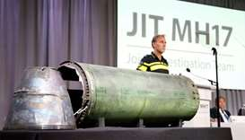 A damaged missile is displayed during a news conference by members of the Joint Investigation Team i