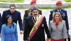 Venezuela's President Nicolas Maduro, accompanied by his wife Cilia Flores, arrives for a special se