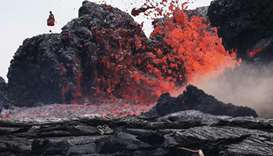 Lava erupts from a Kilauea volcano fissure in Leilani Estates, on Hawaii's Big Island