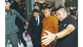 Firebrand Thai monk charged over fraud