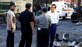Indonesia President Joko Widodo (R) visits a church following an attack, in Surabaya, Indonesia