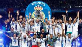 Real Madrid celebrate winning the Champions League with the trophy