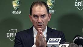Justin Langer speaks to the media in Melbourne, Australia