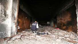 Libya election commission suicide attack toll rises to 14