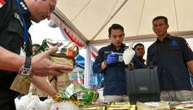 Indonesian police and drugs agency members display packs of methamphetamine in Jakarta
