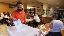 A man casts his vote at a polling station during the parliamentary election, in Sidon, Lebanon