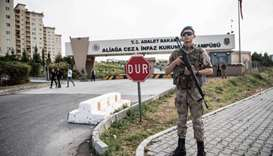 Turkish soldiers stand guard at the entrance of the Aliaga court and prison complex, during the tria