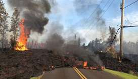 Lava advances along a street near a fissure in Leilani Estates, on Kilauea Volcano's lower East Rift