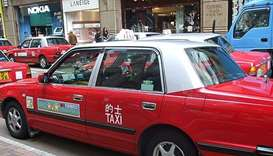Hong Kong cabbie held after $140,000 left in car